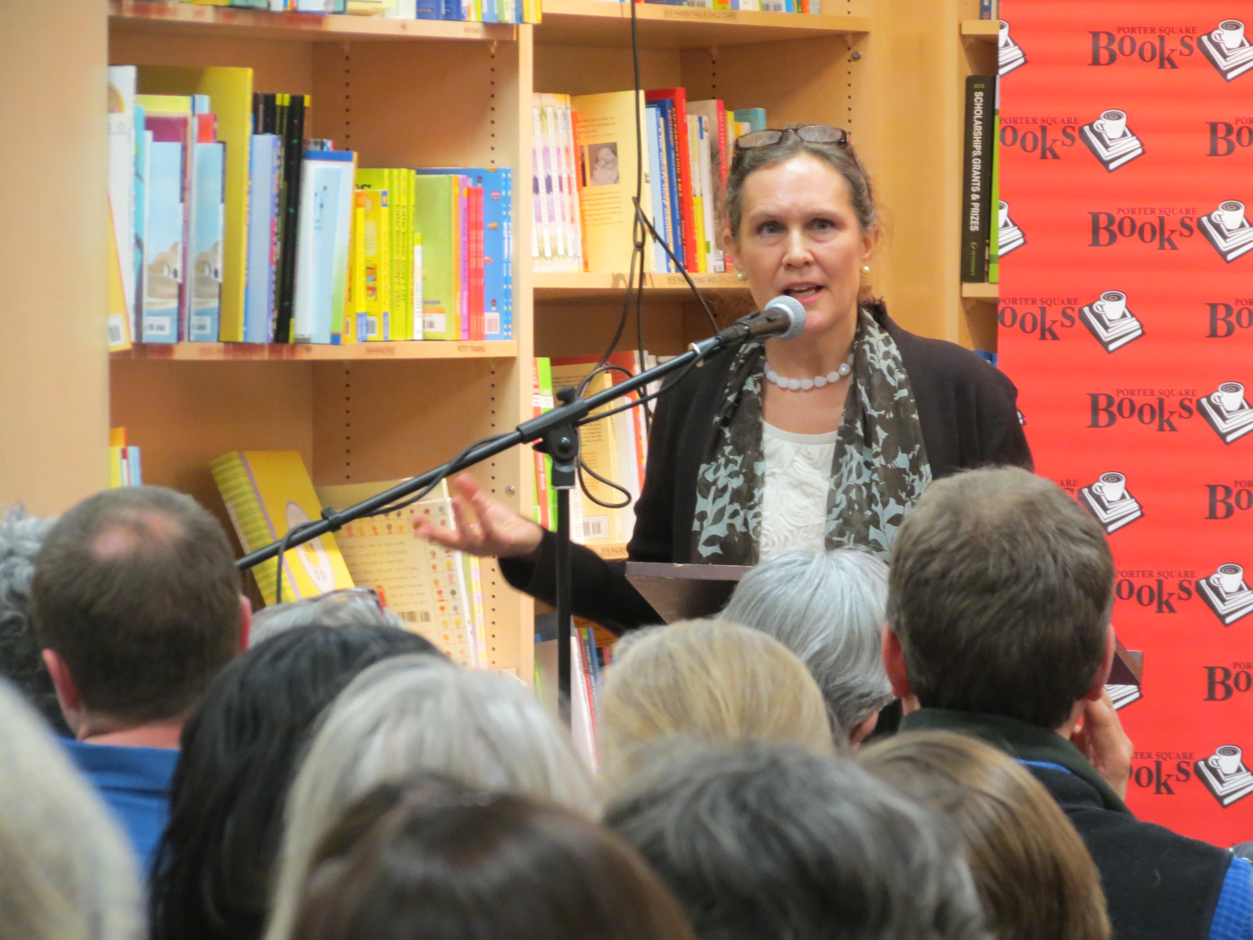 Debby speaking in front of crowd at bookstore