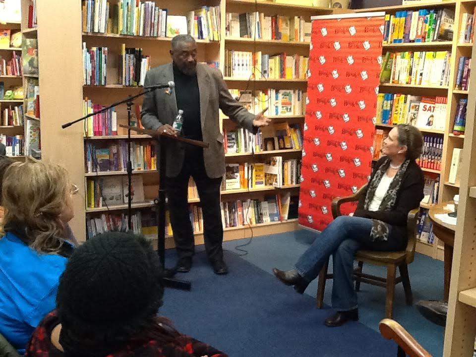 book shop with black man speaking