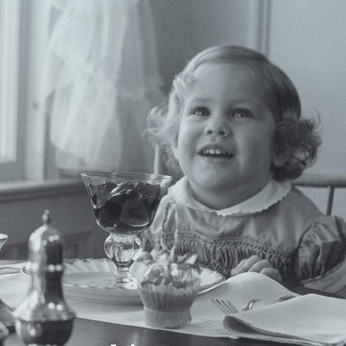 photo of Debby as a baby with a dessert in a stem glass