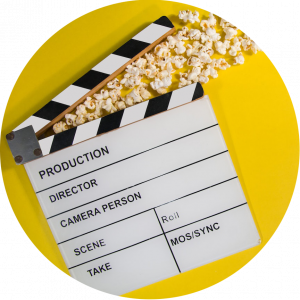 movie clapboard with popcorn coming out of top